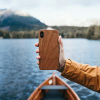 iPhone wooden case. Unique wooden iPhone protection with real wood & polycarbonate shell. Each case is crafted from real wood and hand polished to attain a natural wood shine, before being attached to a sturdy case to ensure outstanding protection against drops or bumps.