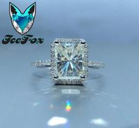 Moissanite - 9x7mm, 2.7ct Radiant Cut EF Moissanite set in a 14K White Gold Diamond Halo - In The IceBox