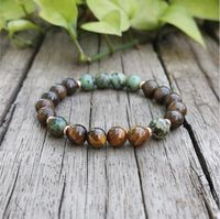 Healing energy bracelet with Bronzite, African Turquoise and Tiger's Eye stones.