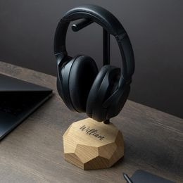 Wooden headphones stand made of premium solid wood and black painted solid steel, unique geometric-inspired design with detailed hand finish make it an extraordinary looking gadget. Universally-sized headphones stand will keep headphones of all sizes securely in place and easily locatable, making it a uniquely stylish and convenient addition to any desk.